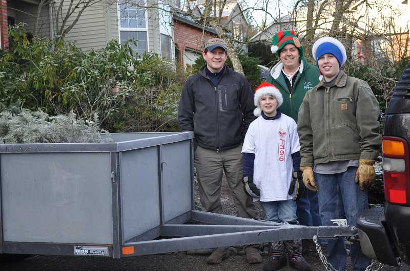 by: SUBMITTED PHOTO - Boy Scout Troop 396 will recycle Christmas trees after the holidays in exchange for a donation.