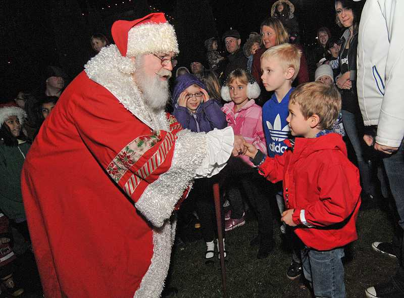 by: VERN UYETAKE - Santa greets 4-year-old Judah Sundstrom of West Linn.
