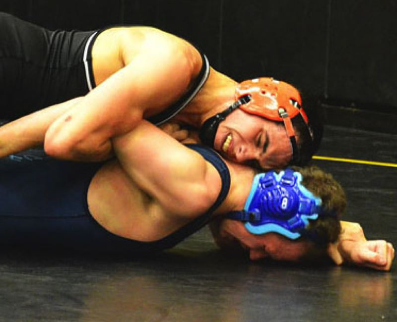 by: JOHN BREWINGTON - Scappoose's Ryan Bond would get a second-round pin against this Mark Morris wrestler Monday in St. Helens. Bond was second over the weekend at the Estacada Ranger Classic.