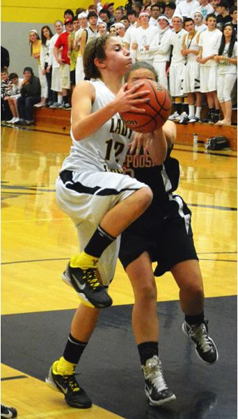 by: JOHN BREWINGTON - St. Helens' Michelle Sass led the scoring in Thursday's game with Scappoose, scoring 16 points.