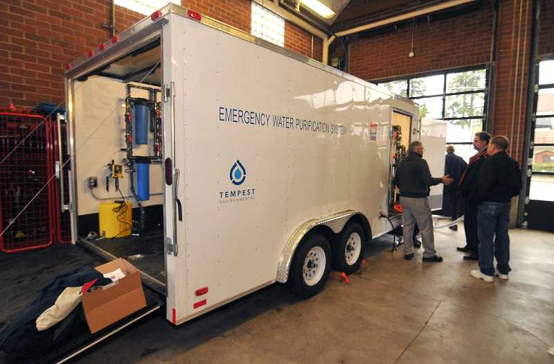 by: VERN UYETAKE - Lake Oswego shows its new trailer-mounted emergency water purification system at the main fire station on Monday. The mobile system can treat up to 30,000 gallons of water each day.