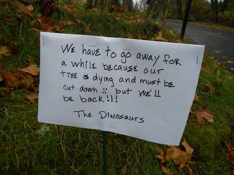by: CLIFF NEWELL - The sign tells the story: The dinosaurs are gone for now but will be coming back.