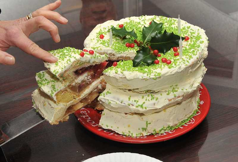 by: REVIEW PHOTO: VERN UYETAKE - Barb Randall made a cherpumple for Review/Tidings assistant editor Kara Hansen Murphy's birthday celebration. The dessert contains cherry, pumpkin and apple pies baked in cakes.