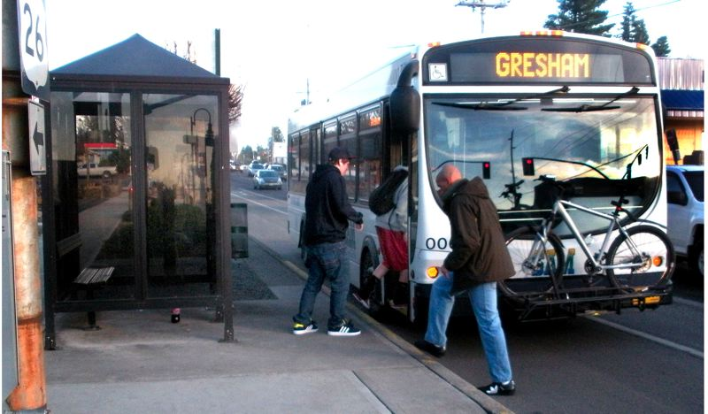 by: POST FILE PHOTO: JIM HART - POST FILE PHOTO: JIM HART A SAM bus stops to take on passengers at one of the many stops in Sandy before making another of its round trips to Gresham. All bus routes will be shortened in January, ending at the new transit center.