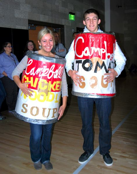 by: CONTRIBUTED PHOTO - Sandy High School students Danielle Stripe and Tyler White helped kick off the canned food drive.