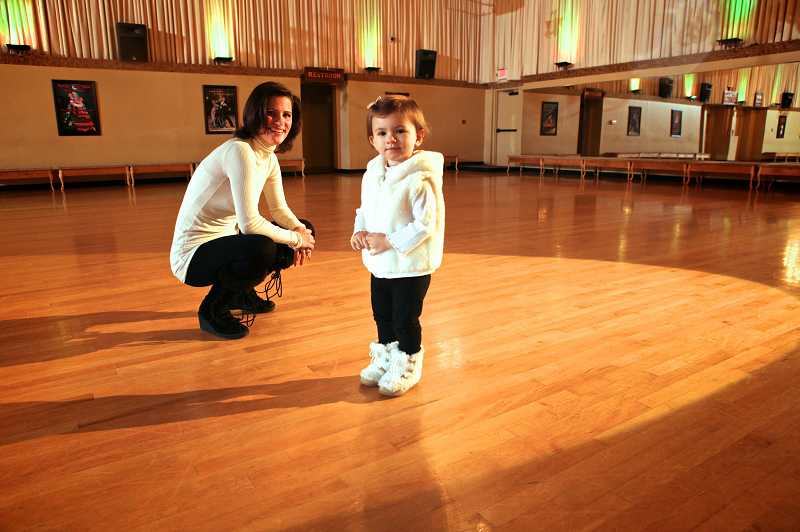 by: TIMES PHOTO: JAIME VALDEZ - Ballroom Dance Company owner Sunnie Page watches her 1-year-old daughter, Summer. The dance studio is the largest in the country at more than 17,400 square feet.