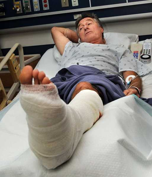 by: COURTESY OF MAUI NEWS - Lake Oswego's Tom Kennedy awaits further treatment at Maui Memorial Medical Center after he was attacked by a shark Friday morning.