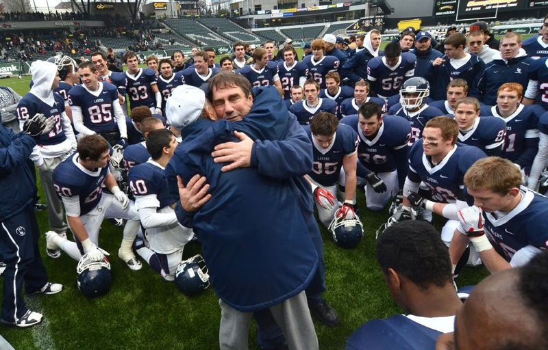 by: TRIBUNE FILE PHOTO - Lake Oswego Lakers coach Steve Coury celebrated after last year's championship game. Coury is not letting his health concerns interfere with his team's chances to stay undefeated.