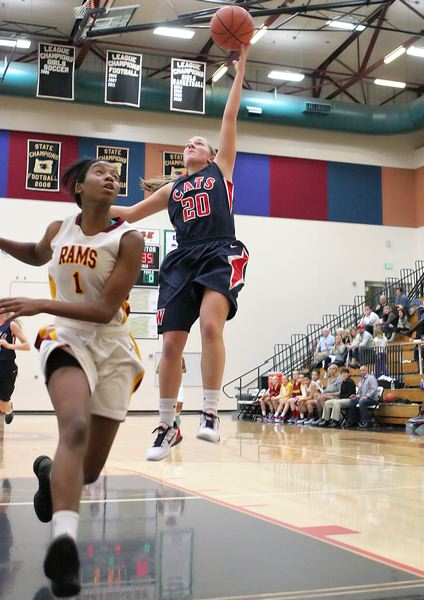 by: MILES VANCE - SHE SCORES - Westview senior Delanie Parry flies over Central Catholic's Jordan Reynolds during her team's Saturday victory in the semifinals of the Northwest Invitational Tournament at Southridge High School.