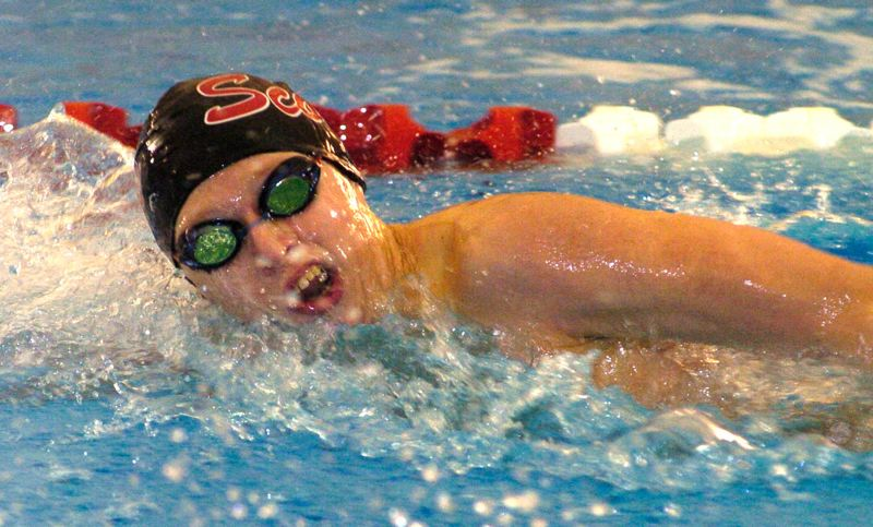 by: THE OUTLOOK: DAVID BALL - Leland Miller of David Douglas takes a breath during a freestyle race at last years district meet. The Scots edged Centennial by a single point in the battle for last years MHC swim title.