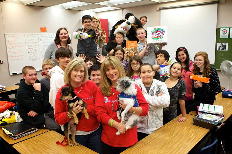 by: JAIME VALDEZ - Oregon Dog Rescue volunteers Sue Bailey (left) and Nancy Truax have been working with Fowler Middle School students to raise money for the no-kill dog shelter Oregon Dog Rescue in Tualatin.