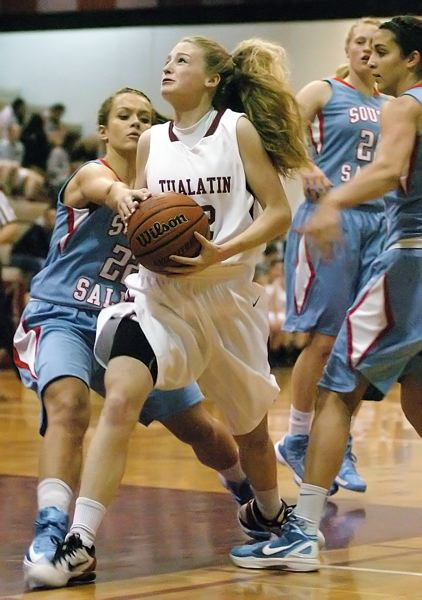 by: DAN BROOD - ON THE MOVE -- Tualatin senior Britta Hall looks to go up to the basket.