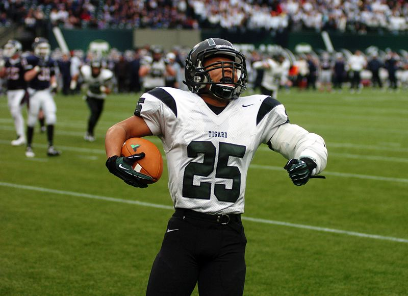 by: DAN BROOD - TIGER TOUCHDOWN -- Tigard High School senior Kaz Greene celebrates after catching an 11-yard touchdown pass from Jett Even late in the second quarter of Saturday's state playoff semifinal game at Jeld-Wen Field. The Tigers fell 42-21 to Lake Oswego.