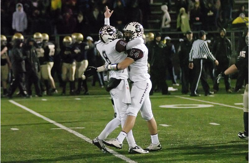by: DAN BROOD - WE'RE NO. 1 -- Sherwood seniors Joseph Balfour (left) and Harrison Shelburne rejoice following the 46-20 win over Marist in the state championship game.