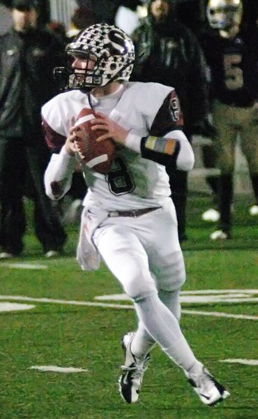 by: DAN BROOD - CHAMPIONSHIP QUARTERBACK -- Sherwood senior quarterback Joseph Balfour looks to throw a pass in Saturday's state title game. Balfour has now been a part of three state championship teams.
