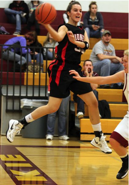 by: JONATHAN HOUSE - Oregon City senior Jenae Paine pushes the pace in the Pioneers season-opener with Milwaukie. Paine is one of three third-year starters in the Pioneer lineup.