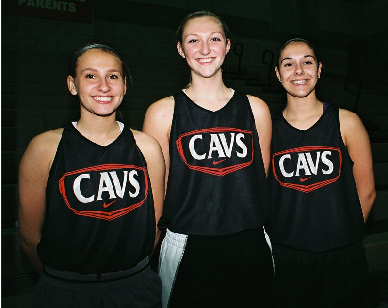 by: JOHN DENNY - Clackamas juniors (from left) Kaitlyn Reiner, Erica Pagano and Sydney Azorr believe that the Cavaliers have the horses to give Oregon City and West Linn a run for their money in the Three Rivers League girls basketball title-chase this winter.