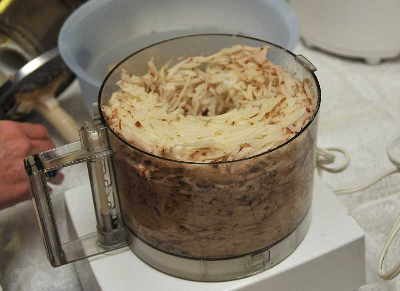 by: REVIEW, TIDINGS PHOTO: VERN UYETAKE - The latkes were made from grated potatoes and onions.