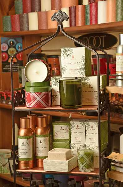 by: REVIEW, TIDINGS PHOTO: VERN UYETAKE - Thymes brand frasier fir candles and products at Dragonfly Greetings & Gifts are most popular this time of year. The scent smells like a real fir tree.