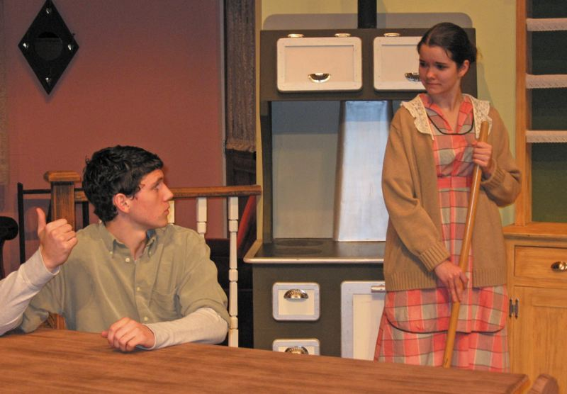 by: MARK SCHWAHN - Chayne Husband, as Clay-Boy, and Grace Ashford, as Olivia, share a quiet moment in 'The Homecoming.'