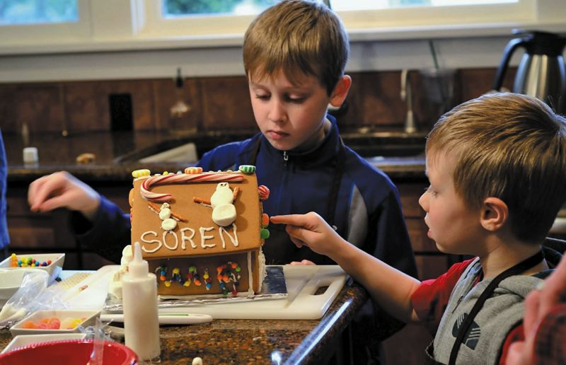 by: SUBMITTED - Max and Soren Rodli each choose a side to decorate in a recent gingerbread-house workshop held at CookingThyme in Happy Valley.