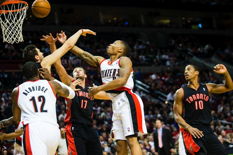 by: TRIBUNE PHOTO: CHRISTOPHER ONSTOTT - Trail Blazers guard Damian Lillard gets a finger-roll shot in Portland's victory at home Monday night over Toronto.