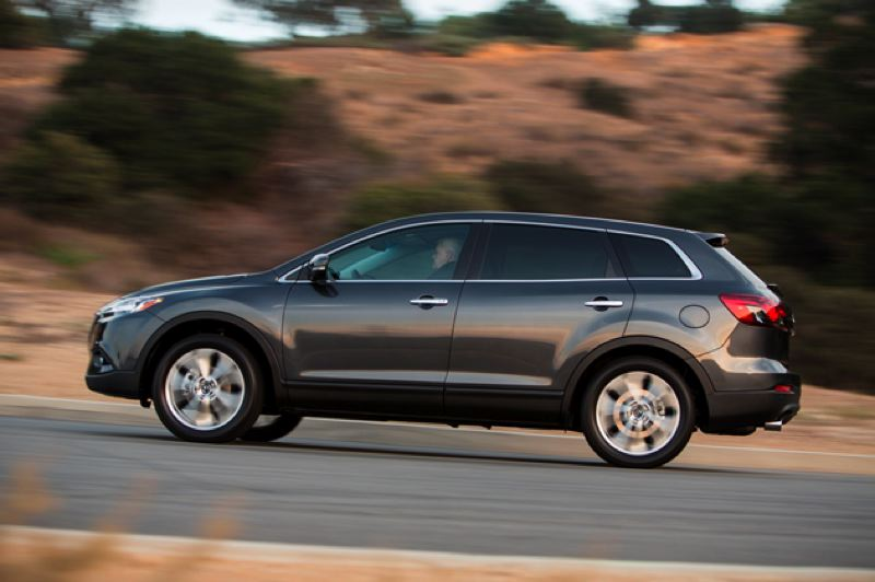 by: MAZDA NORTH AMERICA - 2013 styling revisions improve the looks of the already sporty CX-9.