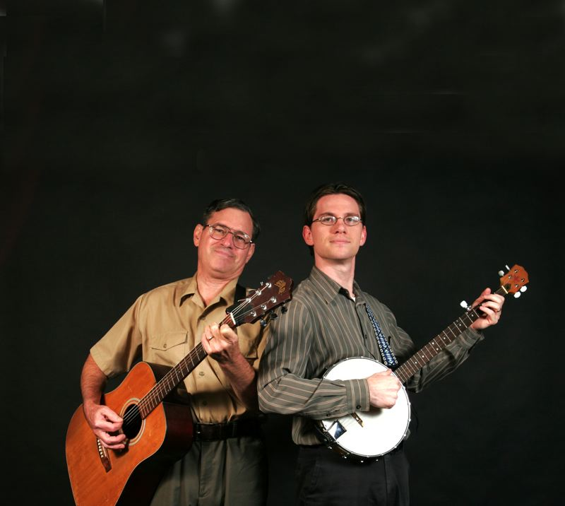 Jere Hudson, left, a retired art teacher, and his son Zach Hudson, a Mt. Hood Community College instructor, turned their love of music into a new children's book called, 'The Banjo.'