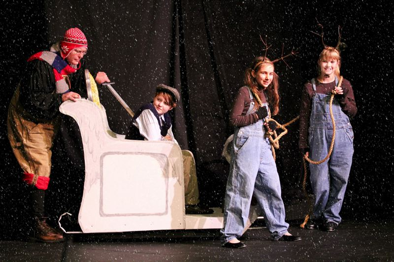 by: COURTESY PHOTO: CHLOE FALLS - The White Witchs evil dwarf (Fred Sherrill) threatens luckless human Edmund Pevensie (Breanna Grimes), while reindeer Alyssa Kittle and Athena VanDyke wait for orders.