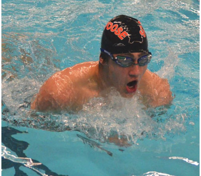 by: JOHN BREWINGTON - Scappoose's Mick Vanek competes on the breast leg of the 200 medley relay during Friday's River City Invitational in St. Helens.