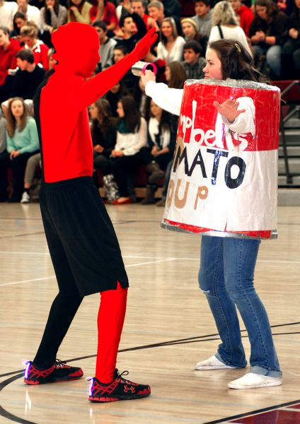 by: CONTRIBUTED PHOTO - Sandy High School student Meghan Luebbert helped kick off the canned food drive during an assembly last week.