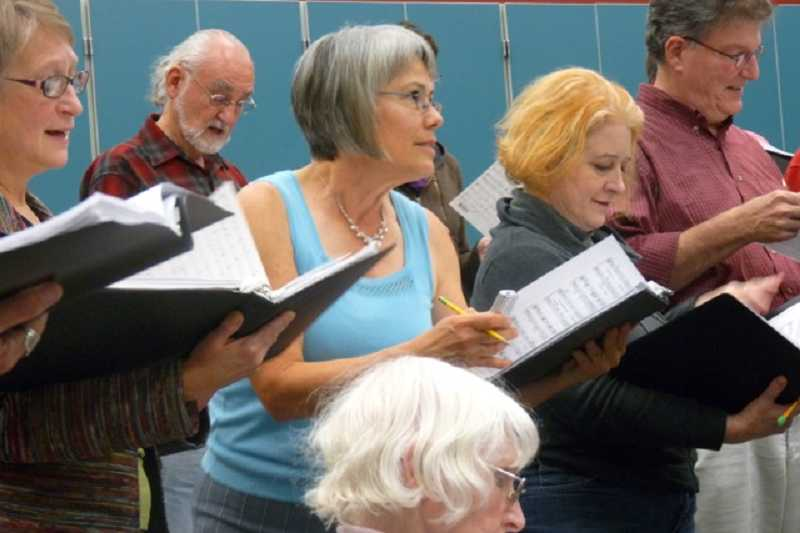 by: DREW DAKESSIAN - Members of The Conchords Chorale rehearse Christmas carols to be performed at Alpenrose Dairy's Christmas in Dairyville celebration this month.