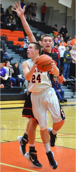 by: JOHN BREWINGTON - The Tribe's Mitchell Davis led the team in scoring with 16 points against Molalla.