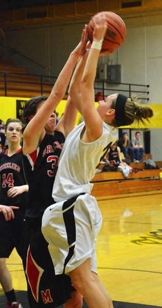 by: JOHN BREWINGTON - St. Helens' Rianne Tupper tries to get a shot off during last Friday's match-up with McMinnville.
