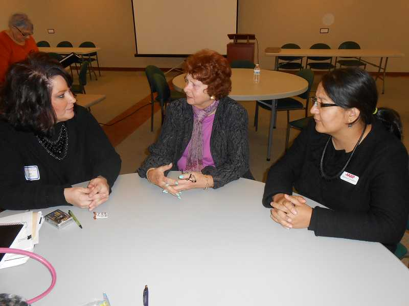 by: CLIFF NEWELL - Doing a recap on the Hidden in Plain Sight forum at the West End Building on Tuesday are, from left, Eileen Collins, Shelley Buckingham and event organizer Bandana Shrestha.