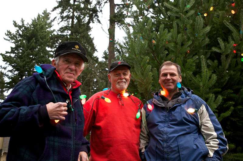 by: JAIME VALDEZ - Neighbors Gary Hanson, Steve Balsiger and John Durst provide Christmas for the neighbors who live on Thistlebrook Court in Durham. Hanson, Balsiger and Durst annually purchase a a Christmas tree and place it in the cul-de-sac and decorate it with Christmas lights. On Sunday, December 9, the neighbors gathered around for the annual tree lighting.