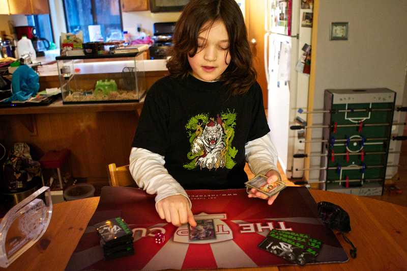 by: TIMES PHOTO: JAIME VALDEZ - Carson St. Denis, 10, of Tigard is currently ranked No. 3 in the world for his skills at Pokemon cards and will be flown to Indiana next year to compete in a national tournament.