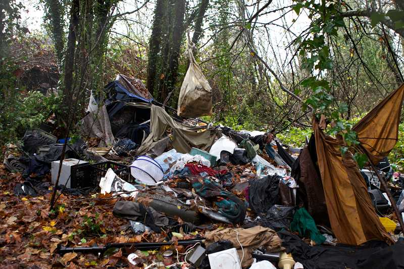 by: TIMES PHOTO: JAIME VALDEZ - Personal belongings litter a homeless camp set up near Southwest Warm Springs Street in Tualatin.