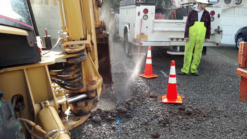 by: CITY OF WEST LINN - A water main break occurred Dec. 6 on Mapleton Drive in the Robinwood neighborhood, affecting 12 homes.