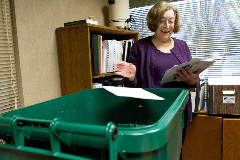 by: TIMES PHOTO: JAIME VALDEZ - Beaverton City Councilor Cathy Stanton recycles one of many letters from Henry Kane as she cleans up her space in the council office on Tuesday.