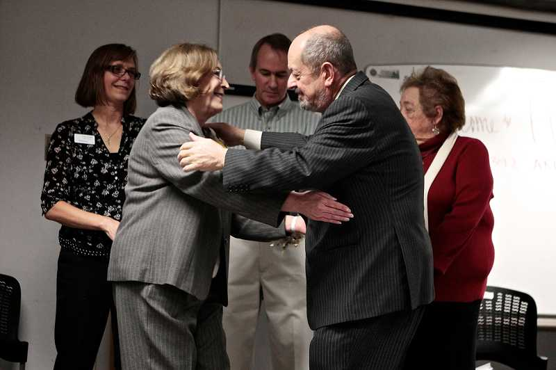 by: TIMES PHOTO: JAIME VALDEZ - Beaverton City Councilor Cathy Stanton receives a hug from Mayor Denny Doyle during a reception Tuesday for Stanton before her last council meeting.