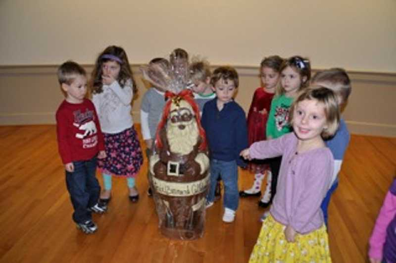 by: SUBMITTED - Children of Christ Church Preschool with the chocolate Santa donated by Bernard C. Chocolates for a charity raffle. SUBMITTED PHOTO