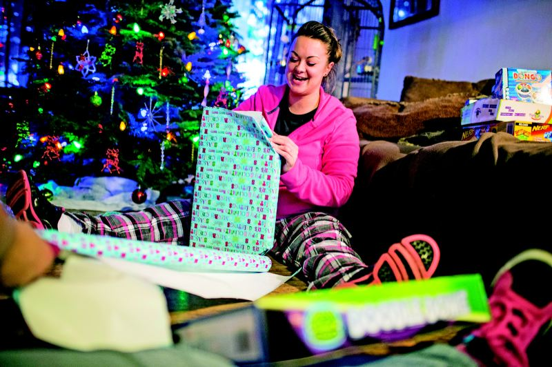 by: TRIBUNE PHOTOS: CHRISTOPHER ONSTOTT - Roseanne Carter is wrapping gifts for the children at Oxford House, a home for recovering addicts. Making the Portland house festive is a gift for the women who live there while rebuilding their lives. TRIBUNE PHOTO: CHRISTOPHER ONSTOTT
