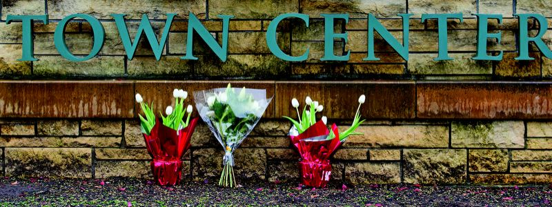 by: TRIBUNE PHOTO: CHRISTOPHER ONSTOTT - Flowers were laid as a memorial outside Clackamas Town Center Wednesday.