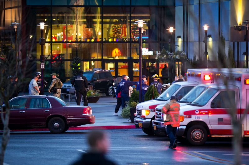 by: TRIBUNE PHOTO: CHRISTOPHER ONSTOTT - Law enforcement and paramedics gathered Tuesday afternoon outside Clackamas Town Center after a gunman shot several people inside the shopping center. Local police agencies plan extra patrols around malls this holiday season.