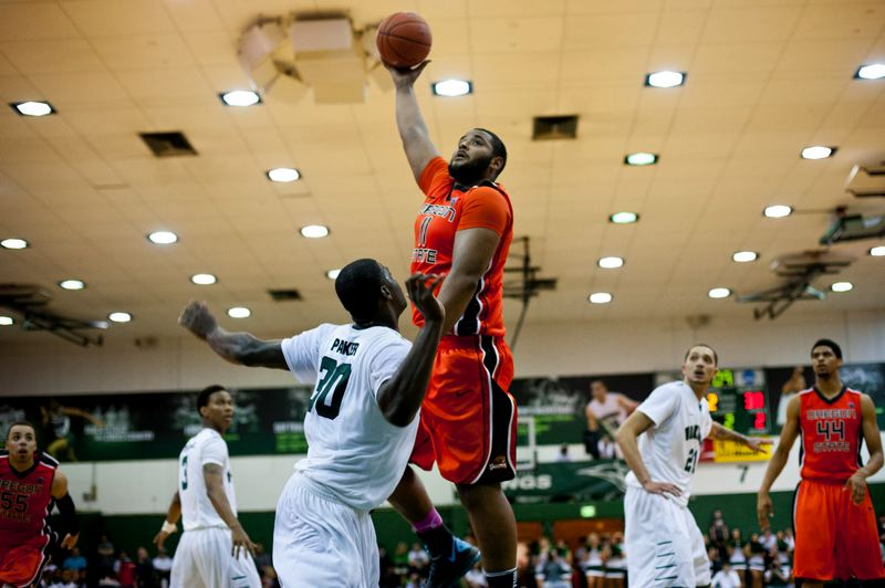 by: CHRISTOPHER ONSTOTT - Oregon State's Joe Burton goes for a hook shot over Portland State's Renado Parker as the Beavers defeat the Vikings 79-74 Wednesday night at Stott Center. Burton had a game-high 20 points, and Parker shared PSU scoring honors with 16 points, as the Vikings (1-5) played the Beavers (6-2) tough before a nonconference sellout crowd of 1,500.