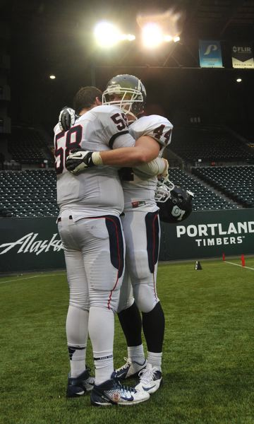by: VERN UYETAKE - Reid Penney and Mitch Lomax share a hug as the season ended.