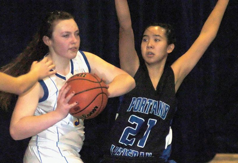 by: THE OUTLOOK: DAVID BALL - Portland Lutherans Rose Ngo puts defensive pressure on a Waldorf ball handler during the Blue Jays 44-43 win Tuesday night.