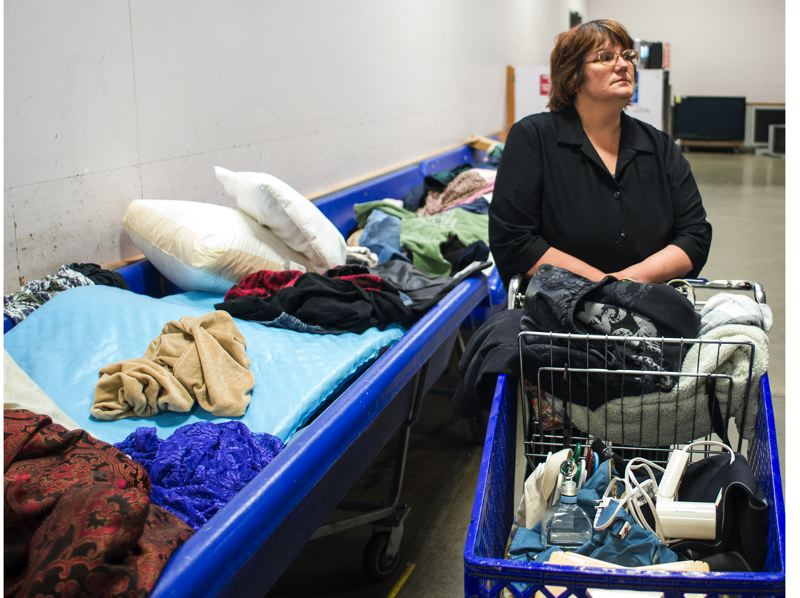 by: TRIBUNE PHOTO: CHASE ALLGOOD - Tina Engelfried searches through the bins at the Goodwill Outlet Store in Hillsboro.