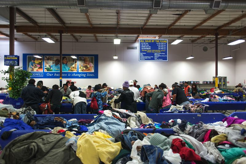 by: TRIBUNE PHOTO: CHASE ALLGOOD - Shoppers at the Goodwill Outlet Store, below. look for real bargains.